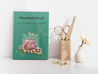 Haushaltsbuch Schwein auf dem Kopf